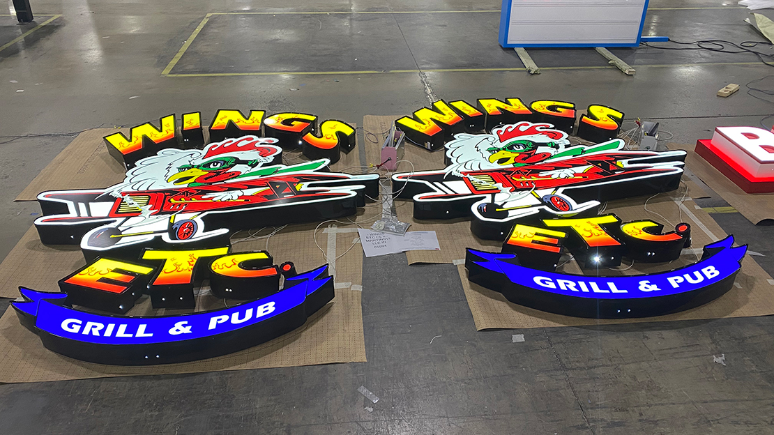 Wings Grill & Pub building sign getting ready for shipment to new location