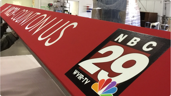 NBC 29 building sign laying on factory floor getting ready for shipment