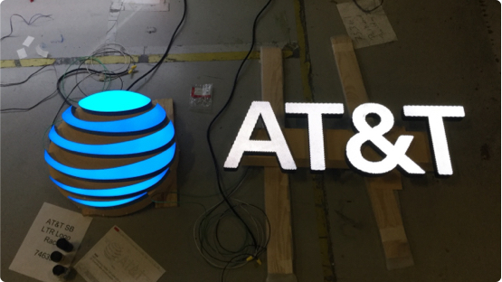AT&T logo LED light laying on factory floor getting ready for shipment