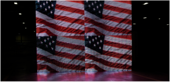 4 screens showing a video of American Flags waving