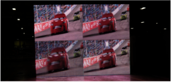 4 screens displaying a video of Lightning Mcqueen from the movie cars driving on a racetrack