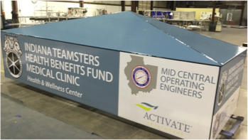 Indiana Teamsters Health Benefits Fund Medical Clinic building sign laying on factory floor getting ready for shipment