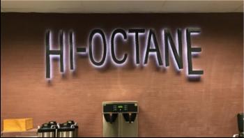 Hi-Octane LED light sign above coffee bar
