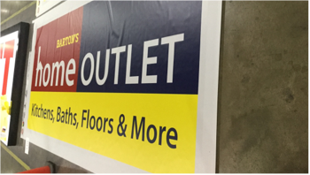 Barton's Home outlet printed on paper sign