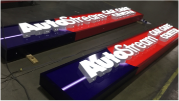 Auto Stream Car Care Center building sign laying on factory floor getting ready for shipment