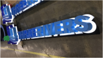 Three Rivers Logo Building Sign being prepared for shipment in factory